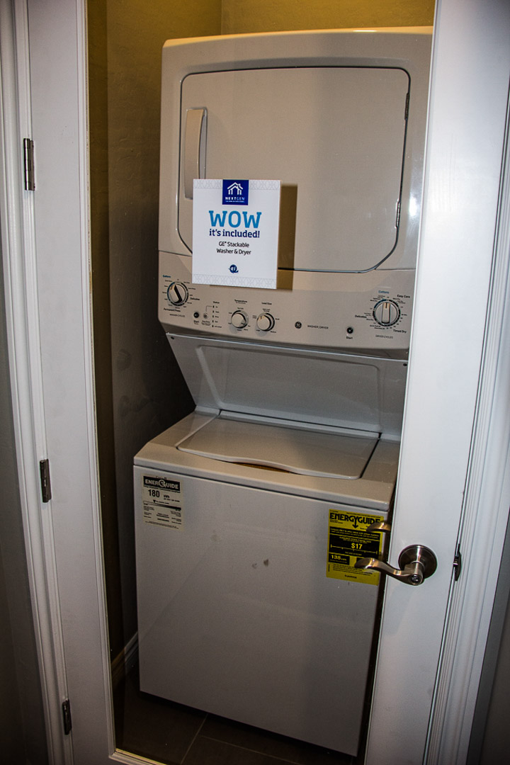Stacking washer/drier in second gen suites